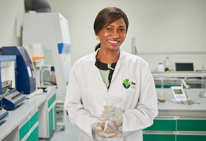 A female cocoa employee in an innovation laboratory, Olam.