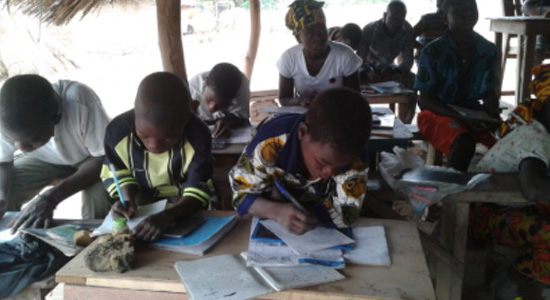 African children studying in a community school, Côte-d'Ivoire, Olam